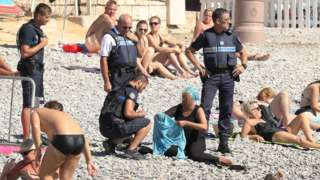 France 'burkini ban': Images of police on beach fuel debate