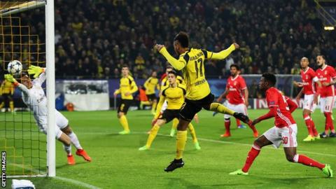 Hat-trick sends Dortmund through