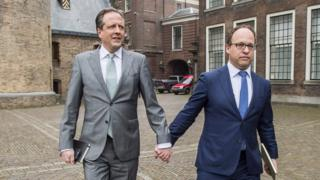 Dutch men hold hands to protest against homophobia