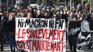 France election: Teenagers protest at candidates Macron and Le Pen